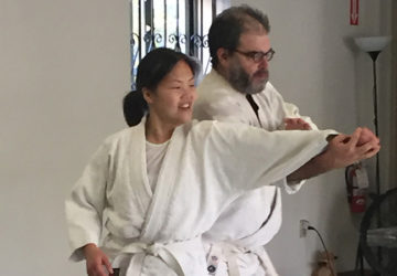 Two students practicing a basic aikido technique