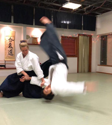 Fiona Blyth throwing aikido student